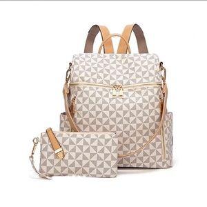 Handbags - NWT BACKPACK PURSE WITH WRISTLET 2pc